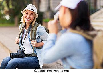tourist posing for photo