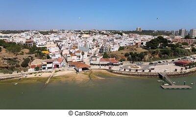 Beautiful town of Alvor by the bay of Atlantic Ocean, ...