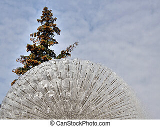 tree on a background of a fountain.