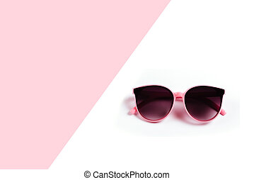 sunglasses isolated on a pink and white background