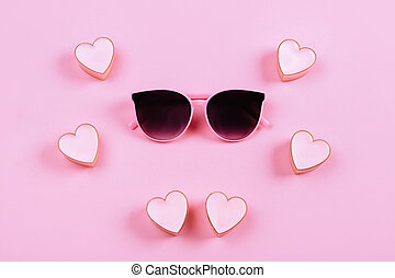 sunglasses on a pink background