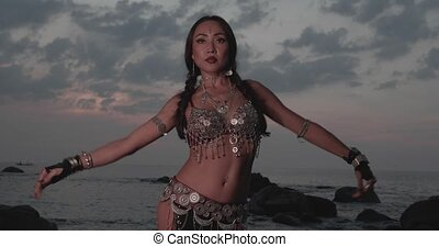 Beautiful tribal belly dancer outdoors