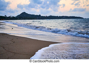 Beautiful tropical beach and sea on sunset