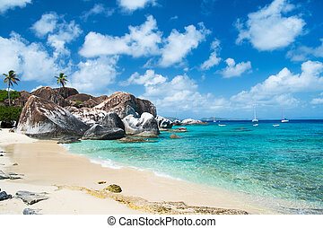 The Baths beach area major tourist attraction at Virgin Gorda, British Virgin Islands with white sand, turquoise water and huge granite boulders