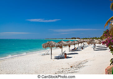 Beautiful tropical beach at the Caribbean island with white sands and stunning turquoise waters. Cuba