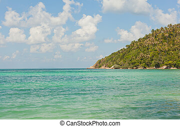 beautiful tropical beach, turquoise water and blue sky