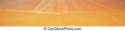 Beautiful Tropical beach with Soft wave of blue ocean, golden sand and sky. Summer travel holiday background concept. Sea panorama with copyspace