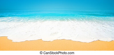 Beautiful Tropical beach with Soft wave of blue ocean, sand and transparent sky. Summer travel holiday background concept. Sea panorama