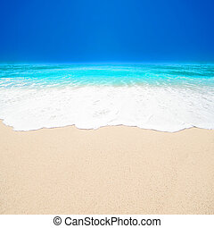 Beautiful Tropical beach with Soft wave of blue ocean, white sand and sky. Summer travel holiday background concept. Sea panorama with copyspace
