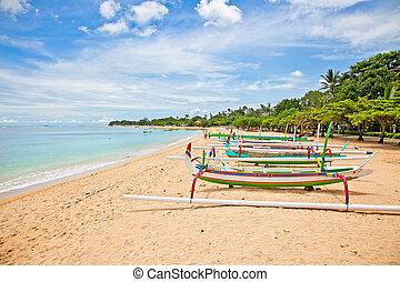 Beautiful tropical beach with fisherman's boats in Nusa Dua...