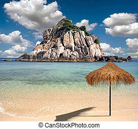 beautiful tropical beach with umbrella