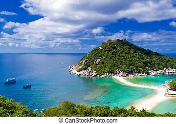 Beautiful tropical island against blue sky with clouds. Koh Phan