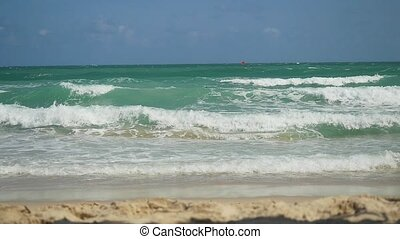 Beautiful tropical turquoise sea water waves on sandy beach...
