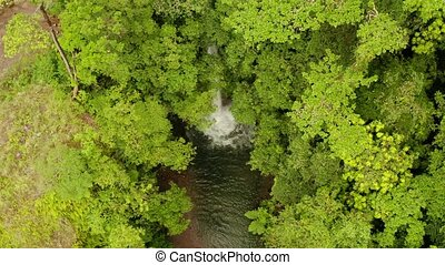 Beautiful tropical waterfall Camiguin, Philippines. -...
