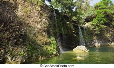 Beautiful tropical waterfall. Philippines, Luzon - Waterfall...