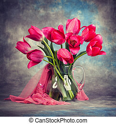 Beautiful tulips in a vase on the table