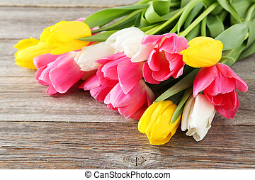 Beautiful tulips on grey wooden background