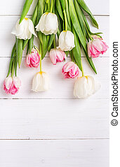 Beautiful tulips on white wooden background. Spring mood