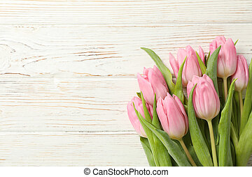Beautiful tulips on wooden background, space for text