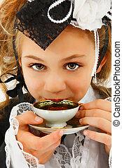 Beautiful Tween Girl in Cosplay Fashion Sipping Tea