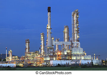 beautiful twilight time in evening of oil refinery plant in heav