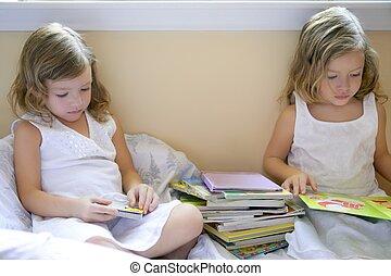 Beautiful twin little girls doing homework