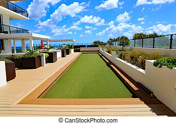 Beautiful, upscale bocce ball court on artificial turf.