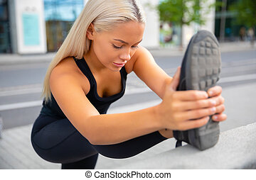 Beautiful Urban Female Stretching Her Leg Before Exercise