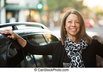 Beautiful Urban Woman Next to Car