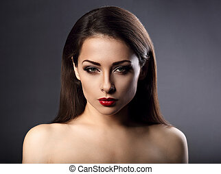 Beautiful vamp makeup sexy woman with hot red lipstick and long eye lashes looking expression on grey background
