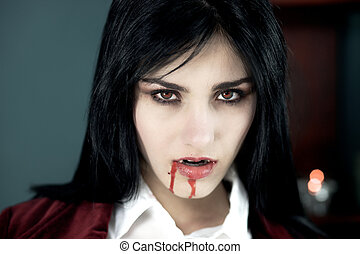 Beautiful vampire with blood looking camera - Scary vampire...