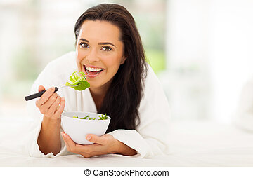 vegetarian eating fresh green salad