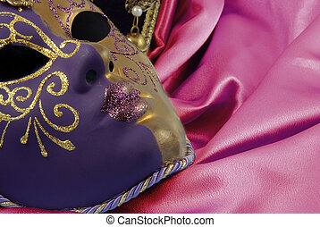 Beautiful Venetian Mask is laying on a Red velvet. Valnentine background