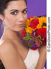 Beautiful Vibrant Female in Bridal Gown with Flowers