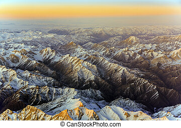 beautiful view from the aircraft to the mountains in Tashkent, china and Kirgistan, covered with snow