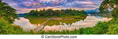 Beautiful view of a bamboo bridge. Laos landscape. Panorama