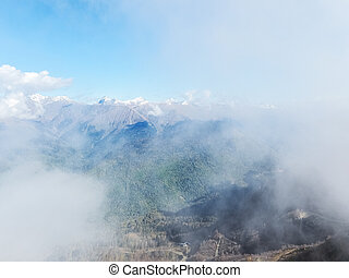 Beautiful view of a mountain valley in a cloudy haze