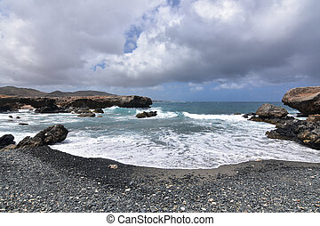 Beautiful View of Black Sand Stone Beach in Aruba