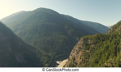 Beautiful View of Canadian Nature during sunny summer day. Aerial Drone Shot. Near Hells Gate, BC, Canada. 4k