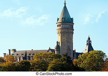 Luxembourg city sight. Beautiful view of castle tower with clock and blue sky. Autumn day