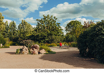 Beautiful view of green city park with flower beds