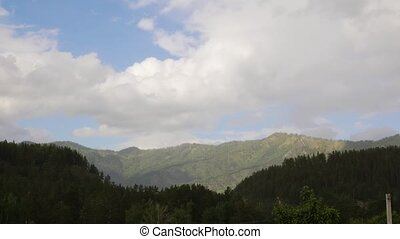 Beautiful view of mountain valley with fast rolling clouds...