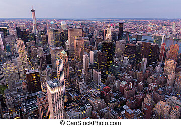new york city with skyscrapers at sunset
