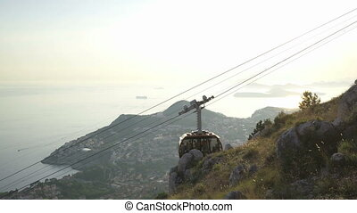 View Of Old City Dubrovnik Cable Car Passing By Sunset...