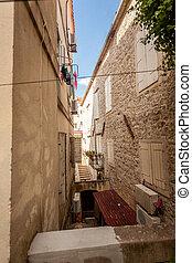 view of old narrow street at city of Budva, Montenegro - ...