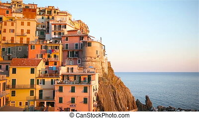Beautiful view of old village of Manarola in the Cinque Terre Reserve at sunset. Liguria region of Italy.