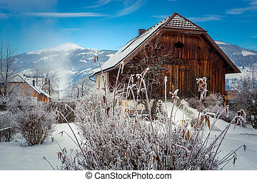 old wooden barn in Austrian Alps covered by snow - Beautiful...