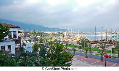 Beautiful view of resort city with boats in bay, Alanya