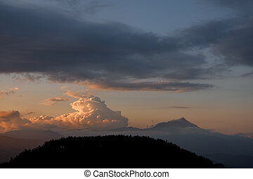 beautiful view of sky with big colorful clouds over mountain silhouette. Beauty in nature.