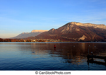 Beautiful view of the Annecy Lake in French Alps in sunset